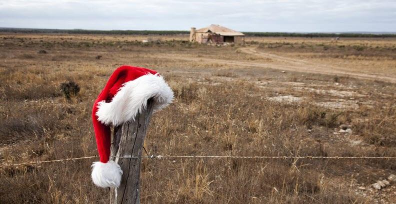 Santa hat on fence post rural